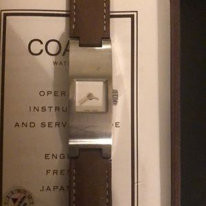 Coach brown leather band with silver face watch